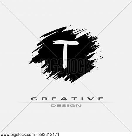 Letter T Logo With Brush Stroke And Splatter Elements. Handwritten Brush Stroke Letter T Logo Design