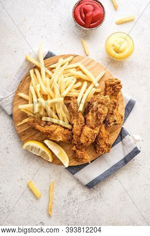 Fish And Chips. Deep Fried Fish Filet And With French Fries On White Background With Sauces. Traditi