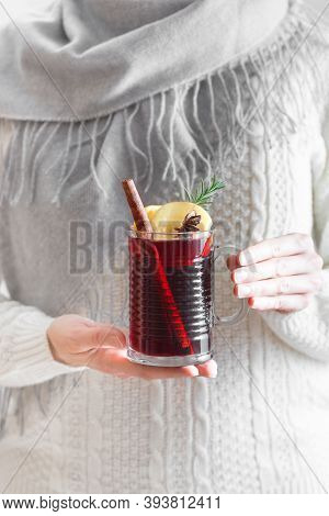 Woman Holding Mug Of Hot Mulled Wine, Copy Space. Female Hands With Cup Of Seasonal Winter Hot Drink