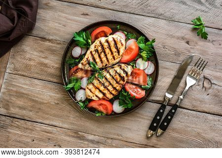 Healthy Lunch With Chicken. Grilled Chicken Fillet And Vegetable Salad With Avocado On Wooden, Top V