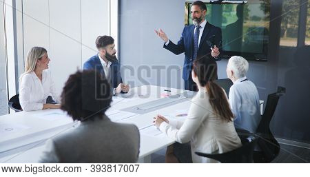 Group Of Happy Business People Working In A Meeting At Office