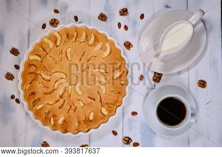 Apple Pie With Nuts And Cup Of Coffee And Creamer. Fruit Cake With Almonds And Walnuts. Home Pie Rip