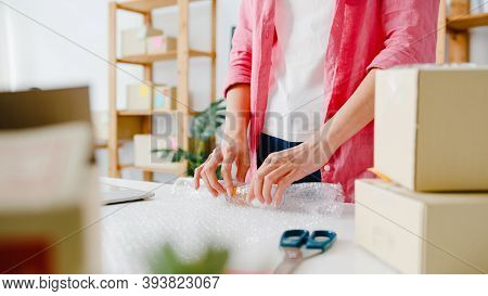 Young Asia Entrepreneur Businesswoman Packing Product In Cardboard Box Deliver To Customer, Working