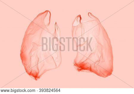 Pink Plastic Bag In Pink Light In Form Of Lungs. World Pneumonia Day. Pneumonia. Covid.