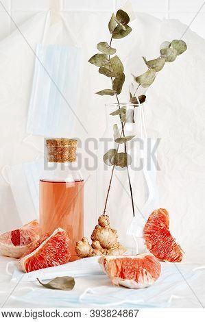 Medical Blue Masks, Grapefruit, Ginger, Bottle With Drink And Eucalyptus Leaves In Glass Bottle