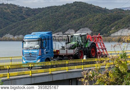 Truck, Trailer, Transporting An Agricultural Machine-tractor. Romania, Severin. November, 03, 2020