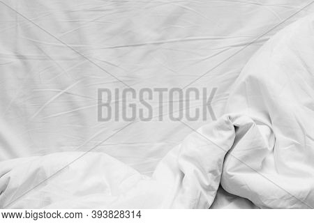 Top View Of White Cotton Crumpled Sheet And Crumpled Blanket With Copy Space. Flat Lay, Top View