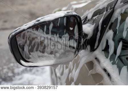 Car Mirror In Soapy Foam At A Car Wash Service. Self-service Car Cleaning, Photography
