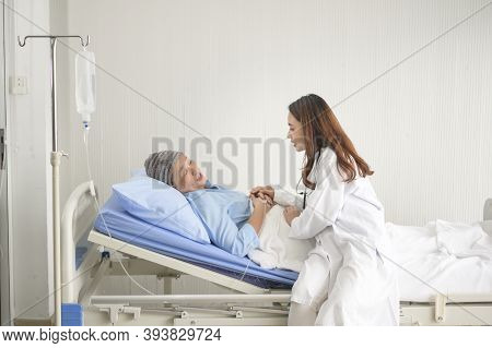 Cancer Patient Woman Wearing Head Scarf After Chemotherapy Consulting And Visiting Doctor In Hospita