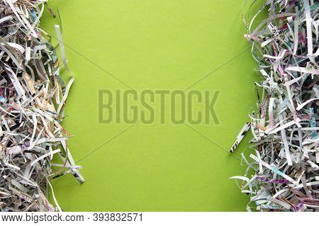 Shredded Paper On Light Green Background. Selective Focus Image.