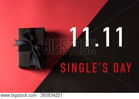 11:11 Sale Shopping Concept, Top View Of Gift Box Wrapped In Black Paper And Black Bow Ribbon With 1
