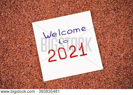 Note Paper With Phrase Welcome To 2021 On Corkboard.