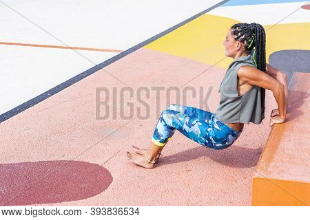 Mature Woman Training Doing Exercises On A Public Neighborhood Sports Court. Copy Space
