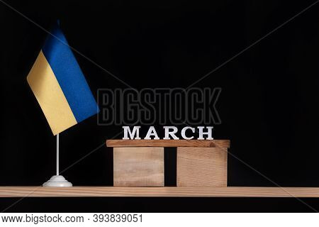 Wooden Calendar Of March With Ukrainian Flag On Black Background. Dates In Ukraine In March.