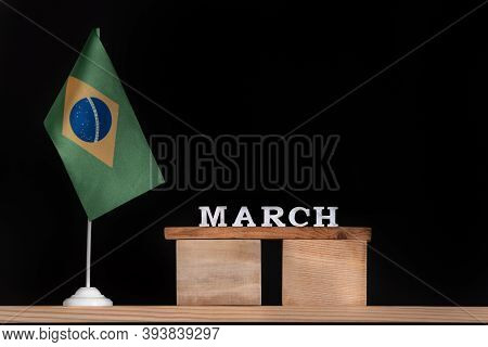 Wooden Calendar Of March With Brazilian Flag On Black Background. Dates Of Brazil In March.