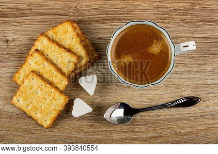 Crunchy Cookies With Sesame, Pieces Of Sugar, Coffee Espresso In Light-blue Cup, Spoon On Wooden Tab