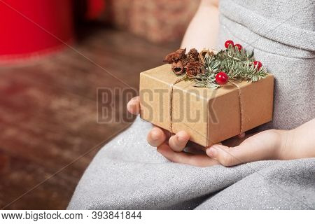 Child's Hands Holding Gift Box. Christmas, Hew Year, Birthday Concept. Festive Background With Bokeh