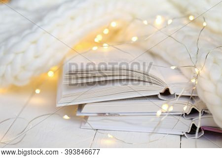 Winter Books. Reading In The Winter Holidays. White Cover Books , Shining Garland And White Knitted