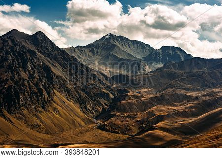Incredibly Beautiful Mountain Landscape. Mountain Peaks In The Sun. Panoramic View Of The Autumn Mou