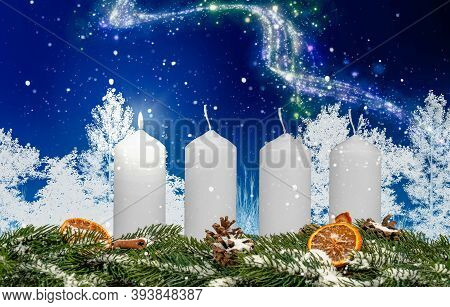 One Candle On An Advent Wreath Burns With Wintery Background And Snow