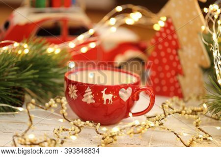Christmas Time. Christmas Tea In A Red Cup, Red Decorative Machine, Red Wooden Tree, Vintage Garland