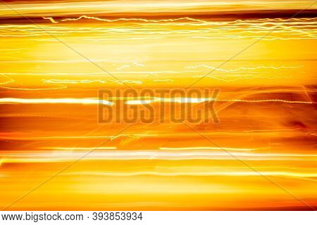 Long Exposure Yellow Orange Light Painting Photography, Ripples And Lines Against Black Background.