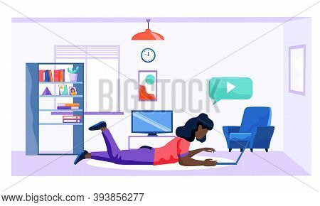 A Girl Lying On The Floor And Working On A Laptop. Home Office. Work At Home Or Freelance. A Young W
