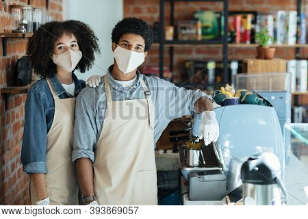 Family Small Business And Work During Covid-19 Epidemic. Millennial African American Couple In Apron
