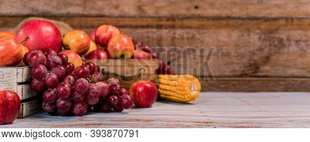 Eco Fruit On Wood Background In Autumn. Agricultural On Harvest Cornucopia Fall Season And Thanksgiv