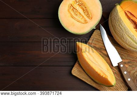 Tasty Fresh Melons On Wooden Table, Flat Lay. Space For Text
