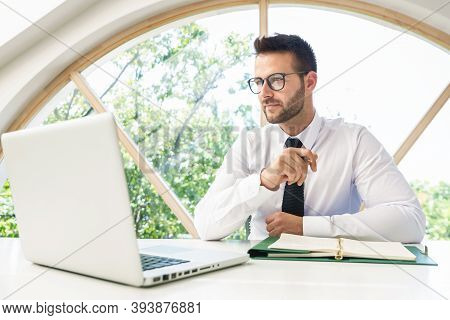 Financial Accountant Businessman Working On Laptop At The Office