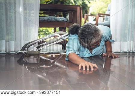 An Elderly Asian Woman Is Patient From Paralysis, Is Falling,  Laying Down On The Floor Outside The