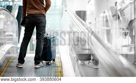 Travel Insurance Concept. Male Tourist Or Passenger Man Carrying Suitcase Luggage And Digital Tablet