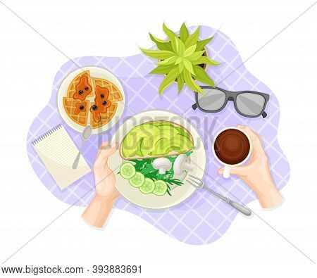 Hands Holding Plate With Sliced Vegetables And Sandwich Served On Plate Rested On Checkered Table Cl