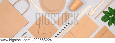 Banner With Flat Lay Composition With Eco-friendly Tableware - Set Of Kraft Paper Packaging On Light