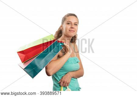 Friendly Expression Adult Woman Wearing Summer Attire Carrying Colourful Shopping Bags With Blank Co