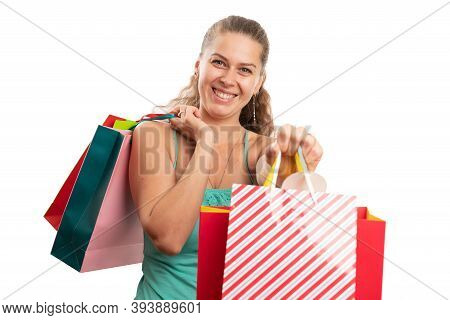 Woman Model Presenting Shopping Bag As Offering Gift Concept With Cheerful Smile Happy Expression We