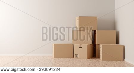 Brown Moving Storage Cardboard Boxes Stacked In Empty Room In Apartment Or House With Wooden Floor W