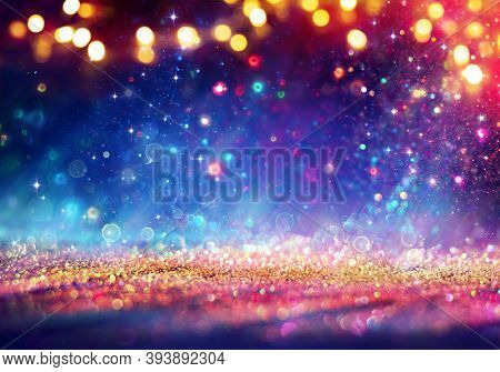 Abstract Defocused Christmas Background - Shiny Golden Glitter With Blurred Lights On Blue Backgroun