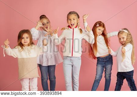 Thumbs Up. Portrait Of Little Caucasian Children Isolated On Pink Studio Background With Copyspace.