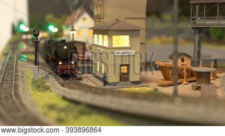 Toy Lokomotive On A Station. Toy Plastic Railway.
