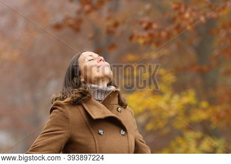 Middle Aged Woman Wearing Brown Jacket Breathing Deep Fresh Air In A Forest In Autumn