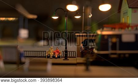 Miniature People On A Retro Railway Station. Railway Station Platform.