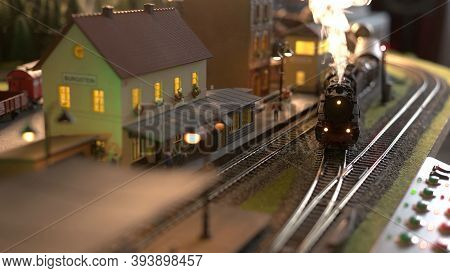 Replica Model Of Railway Station. Coming Lokomotive Train.