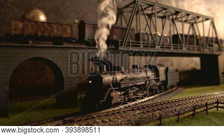Lokomotive With Steam Smoke. Retro Miniature Railway Model.
