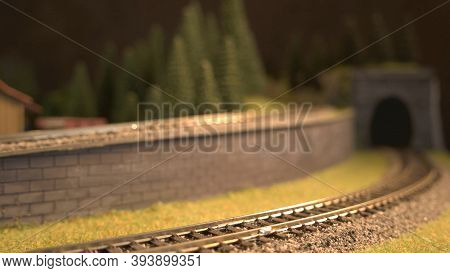 Close-up Toy Railroad. Miniature Railway Model And Tunnel.