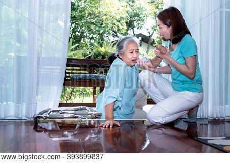 An Asian Elderly Woman Is Patient From Paralysis, Is Falling, Laying Down On The Floor Outside The D