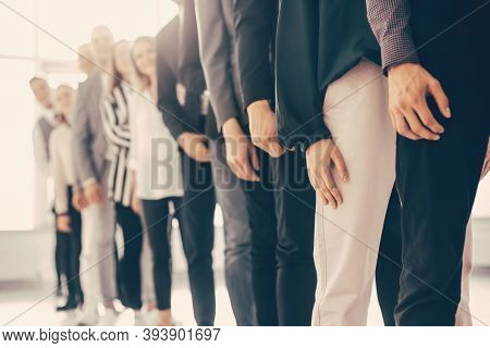Image Of Young Business People Standing In A Long Queue