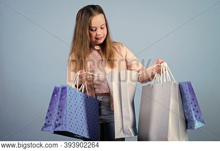 In Shopping Store. Kid Fashion. Shop Assistant With Package. Sales And Discounts. Happy Child. Littl