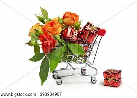 Gifts And Flowers In The Shopping Cart. Buyer's Basket. Full Shopping Cart.  The Concept Of Gifts An